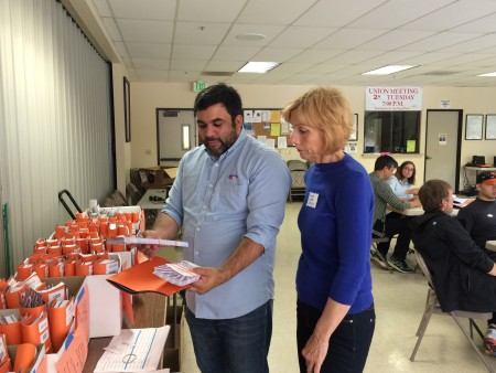 SBLC Political Director Dennis Raj instructs a field volunteer on distributing campaign literature